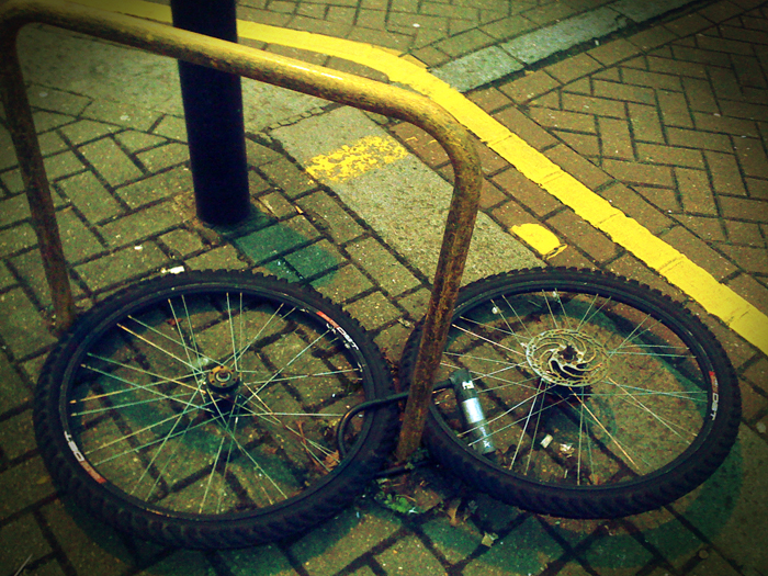 Bike wheels left with padlock as bike frame is stolen)