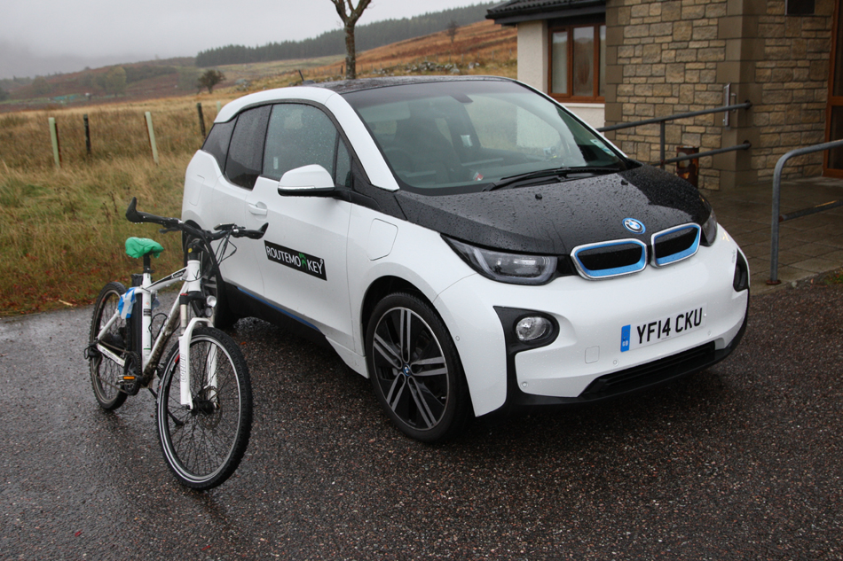 VOLT Alpine electric mountain bike next to BMW electric car