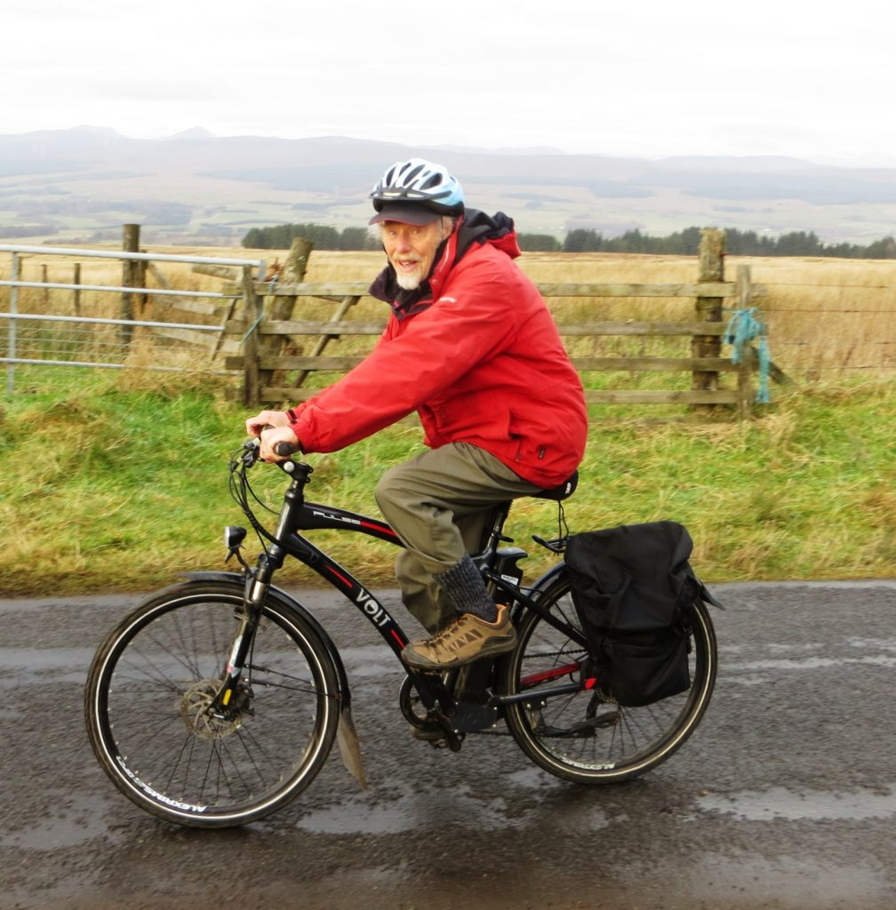 80-year-old cyclist Roy Baker rides his VOLT Pulse e-bike through the fields