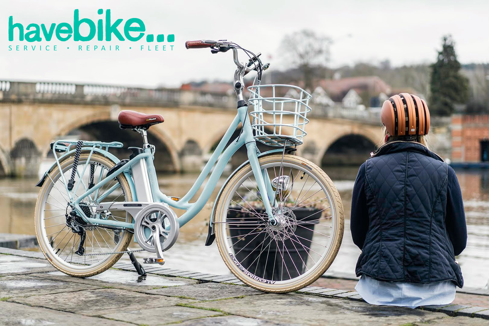 A cyclist sits with her VOLT Kensington along a canal