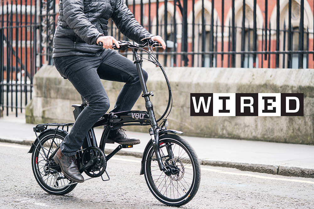 A cyclist rides the VOLT Metro folding e-bike for WIRED