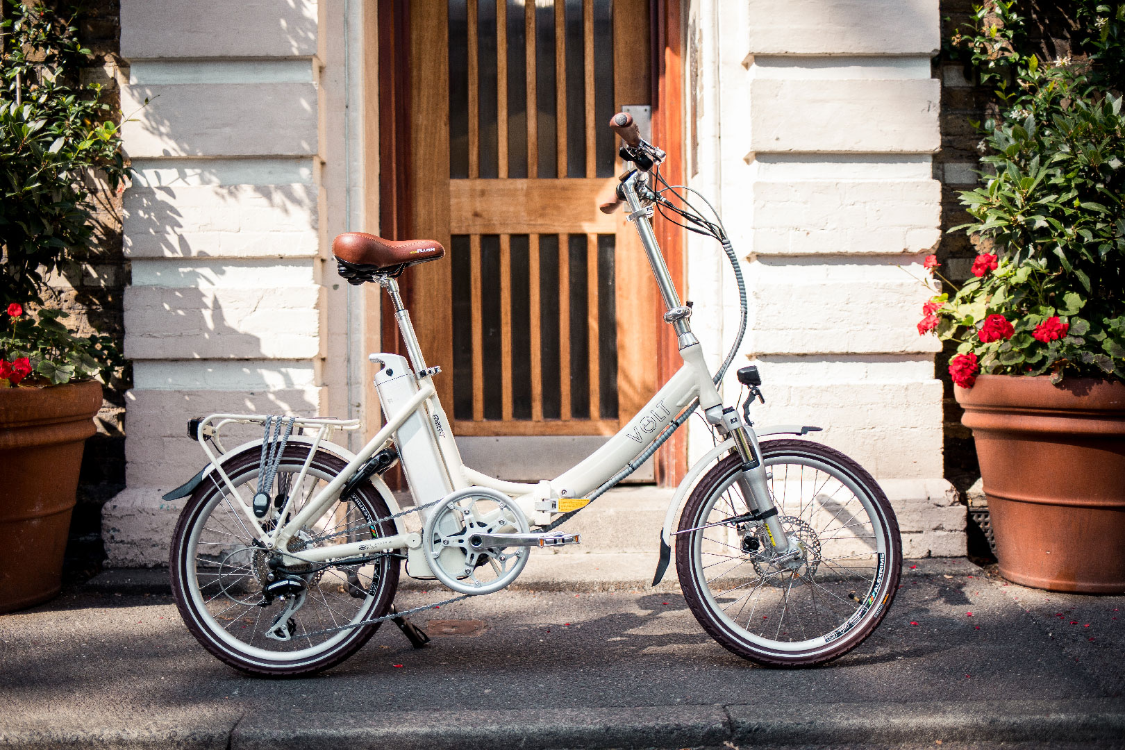 Volt Metro LS Cream Folding ebike beautiful flower background
