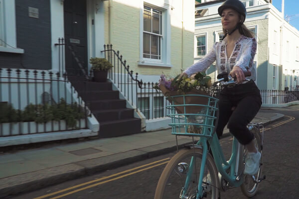 Woman riding Volt Kensington electric bikes in London